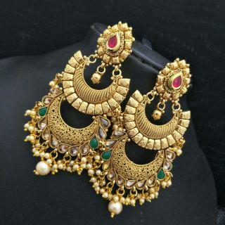 long dangling guranteed pearl earrings